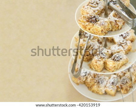 Banquet - Delicious dessert with nuts arranged on buffet table at restaurant. empty copy space for inscription. sweet food background.  - stock photo