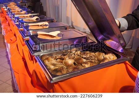 Banquet meal trays served on tables - stock photo