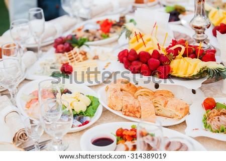 Banquet table served with delicious food - stock photo