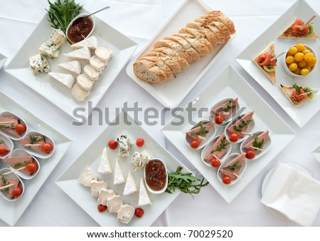 Banquet Table Setting With Bouquet - stock photo