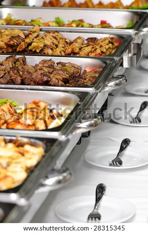 banquet table with chafing dish heaters