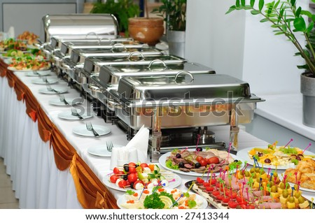 banquet table with chafing dishes - stock photo