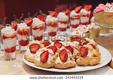 Banquet table with desserts - stock photo