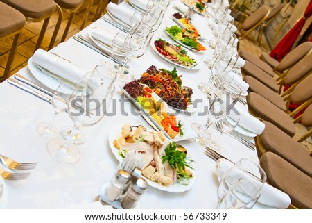 Banquet. Table with food. Glasses, plates and forks. - stock photo