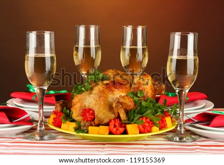 banquet table with roast chicken on brown background close-up. Thanksgiving Day - stock photo