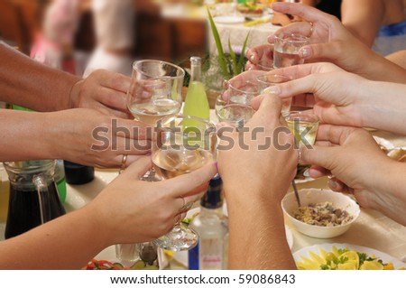 Banquet - the group of people drinks alcoholic drinks. - stock photo