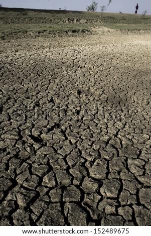 BANSHBARIA, BANGLADESH - APRIL 2008: Cracked ground on the way from Rajshahi to Nachole, Bangladesh. - stock photo