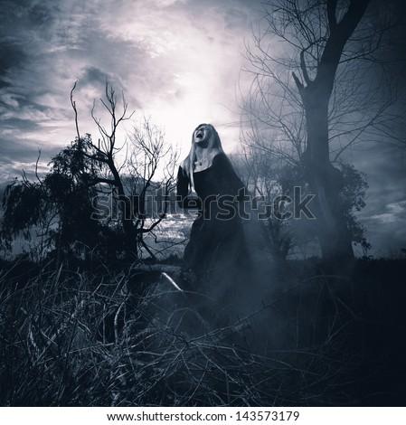 Banshee. Fantasy style portrait of a howling woman, monochromatic shot - stock photo