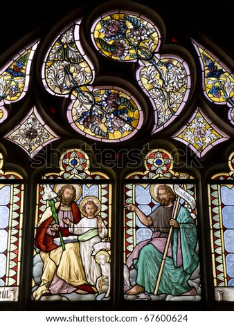 Banska Stiavnica - HolyJoseph and the holy John the Baptist from windowpane - st. Katharine church - stock photo