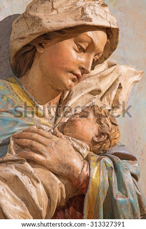 BANSKA STIAVNICA, SLOVAKIA - FEBRUARY 5, 2015: The detail of carved statue of Madonna (Fligh to Egypt sculptural group) as the part of baroque Calvary from years 1744 - 1751 by Dionyz Stanetti. - stock photo