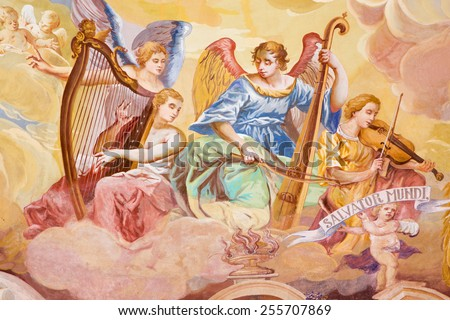 BANSKA STIAVNICA, SLOVAKIA - FEBRUARY 20, 2015: The detail of fresco on cupola in the middle church of baroque calvary by Anton Schmidt from years 1745. Angels with the music instruments. - stock photo