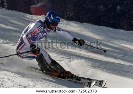 BANSKO, BULGARIA - FEBRUARY 27 : GRANGE Jean-Babtiste (FRA) attacks a gate during Audi FIS Alpine Ski World Cup Men's Slalom on February 27, 2011 in Bansko, Bulgaria.
