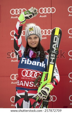 BANSKO, BULGARIA - MARCH 1, 2015: Anna Fenninger (AUT)  takes 1st place during the Audi FIS Alpine Ski World Cup Ladies' Super G  in Bansko, Bulgaria - stock photo