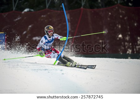 BANSKO, BULGARIA - MARCH 1, 2015: Anna Fenninger (AUT)  takes 1st place during the Audi FIS Alpine Ski World Cup Ladies' alpine combined on March  1, 2015 in Bansko, Bulgaria.