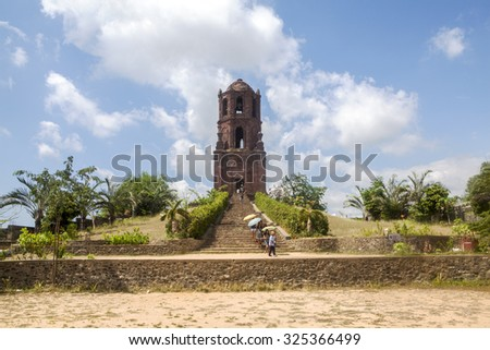 Bantay, Ilocos Sur, Northern Luzon Island, Philippines - April 28, 2015: Tourists visit the Bell Tower, ancient remains of a church built by the Spanish in 1591. - stock photo
