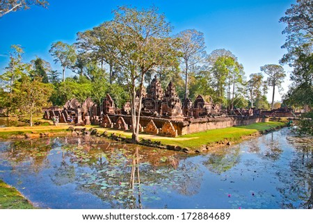 Banteay Srei temple, caled temple of woman, in pink sandstone. Angkor wat complex, near Siem Reap, Cambodia. - stock photo