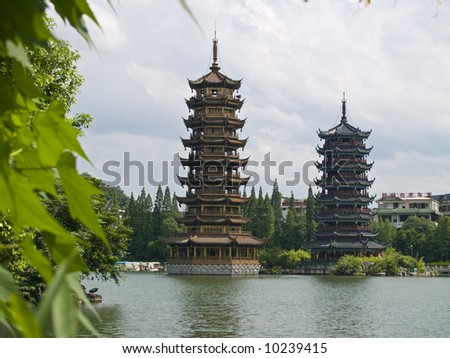 Banyan Lake Pagodas, Guilin, China ,one represents the sun, the other the moon - stock photo