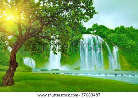 Banyue or Ban Gioc waterfall along Vietnamese and Chinese board. - stock photo