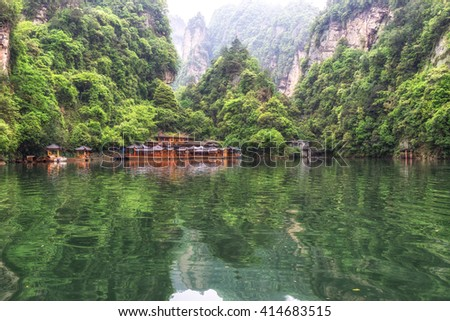 baofeng lake scenery with lush forest surrounding the tall stone peaks. small dock among the forest. Wulingyuan scenic area, Zhangjiajie, China