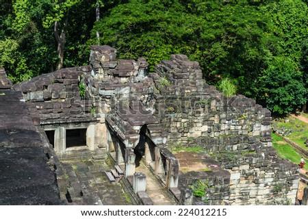 Baphuon, a temple at Angkor, Cambodia. Built as the state temple of Udayadityavarman II dedicated to the Hindu God Shiva. - stock photo