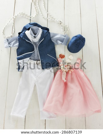 baptism clothes in plan for boys and for girls - stock photo
