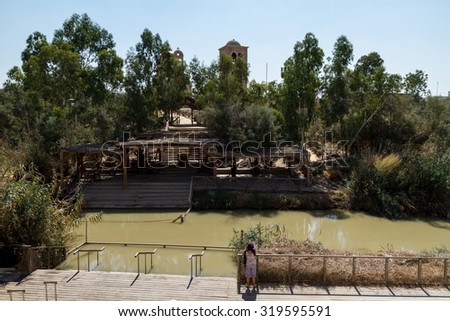 Baptismal site Qasr el Yahud on the Jordan river near Yericho is according to the bible the place where Jesus Christ is being baptized by John the baptist - stock photo