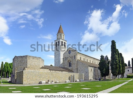 Baptistery of Bishop Chromatius and Basilica di Santa Maria Assunta and bell tower of Aquileia, Italy. Aquileia is UNESCO World Heritage Site - stock photo
