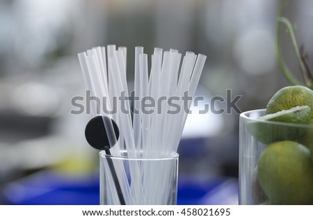 Bar background with empty White Drinking Straws Set and glass with lime,lemon prepared for cocktail. Cocktails ingredients. Bar  - stock photo