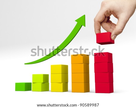 Bar chart made color blocks. Hand puts another block on the top of the highest bar - stock photo