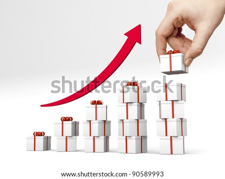 Bar chart made of gift boxes with red ribbon. Hand puts another gift box on the top of the highest bar. - stock photo