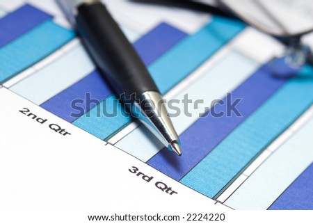bar chart with pen and glasses in macro
