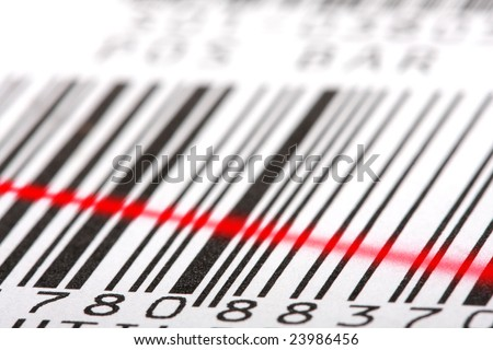 Bar-code label with red laser beam. Close-up shot, shallow DOF. Perfect background for your warehouse concepts artwork. - stock photo