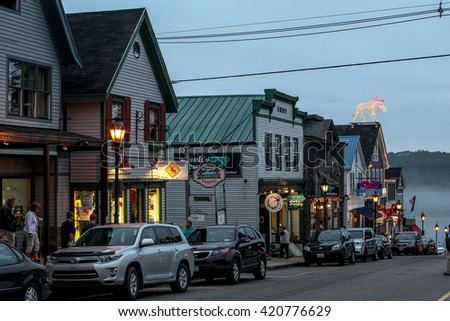 BAR HARBOR - JULY 9: Maine Street with tourist enjoying nice evening  in down town on July 9, 2013 in Bar Harbor, Maine. - stock photo