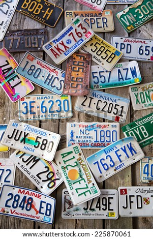 BAR HARBOR, MAINE - AUGUST 28: Old car license plates on a wall in Bar Harbor. In the United States, each jurisdiction has a unique design, usually displaying symbols of the issuing state. August 28 2014 - stock photo