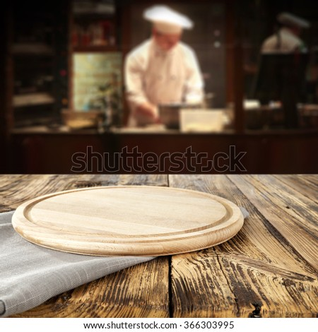 bar interior with chef of kitchen and board of wood  - stock photo