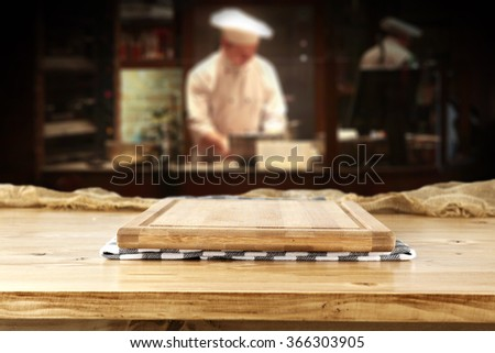 bar interior with chef of kitchen and desk of yellow wooden and pizza space  - stock photo