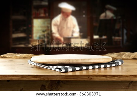 bar interior with chef of kitchen and napkin and desk and hat  - stock photo