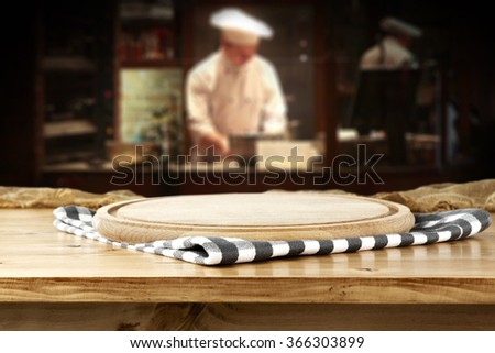 bar interior with chef of kitchen and napkin and pizza space  - stock photo
