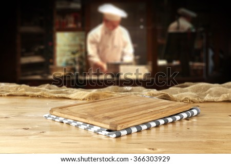 bar interior with chef of kitchen and top of wood and free place  - stock photo