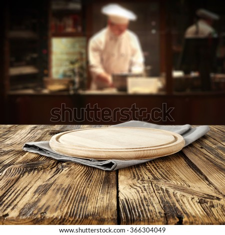 bar interior with chef of kitchen and wooden desk  - stock photo