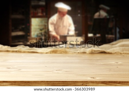 bar interior with chef of kitchen and yellow desk top  - stock photo