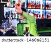 Bar inventory at nightclub. Barman professional making cocktail drinks in background soft focus - stock