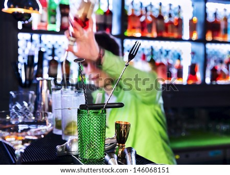 Bar inventory at nightclub. Barman professional making cocktail drinks in background soft focus - stock photo