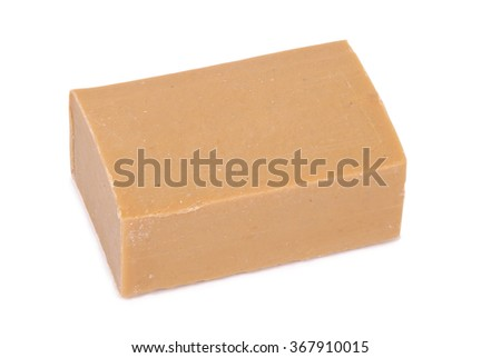 Bar of brown household soap isolated on white. Clipping path - stock photo