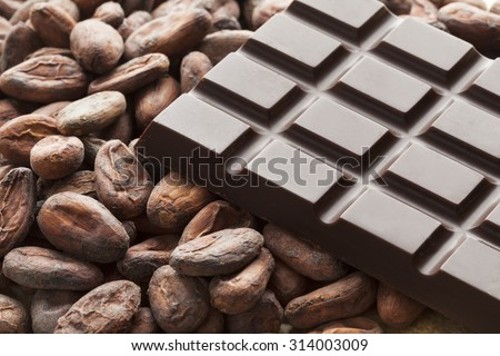 Bar of chocolat with raw cocoa beans   - stock photo