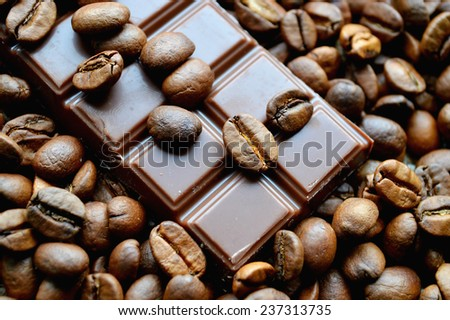 bar of chocolate, coffee beans - stock photo