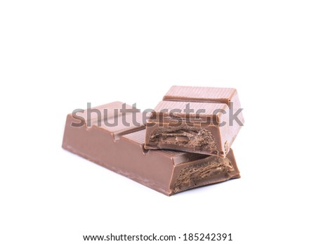 Bar of chocolate with a filling. Isolated on a white background.
