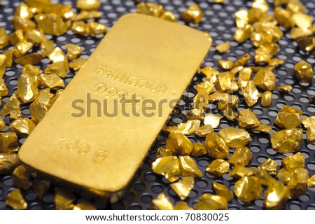 bar of gold and nugget - stock photo