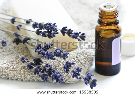 Bar of natural aromatherapy soap with dried lavender and essential oil - stock photo