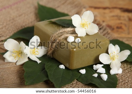 Bar of natural handmade soap on leaves. Spa - stock photo